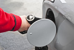 Full tank of fuel. A man filling tank with diesel stock images