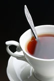 Full tea cup with spoon Royalty Free Stock Photography
