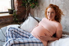 Full Term Pregnant Woman Having Rest At Home Stock Image
