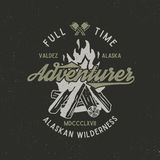 Full time adventurer vintage label with textured bonfire, axe and type elements. Alaska wilderness retro emblem. Vector. Letterpress effect Royalty Free Stock Photos