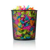 Full trash with colored paper on white background Royalty Free Stock Image