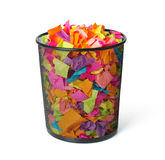 Full trash with colored paper on white background Royalty Free Stock Photo