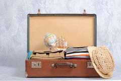 Full travel suitcase on grey background, opened case with travel clothing, accessories. Banner mockup with copy space. Travel or t. Ourism, vacation, holiday royalty free stock photo
