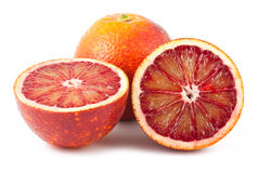 Full and two half of blood red oranges Stock Photo