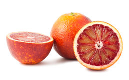 Full and two half of blood red oranges Stock Image