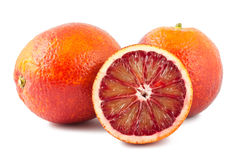 Full and two half of blood red oranges Stock Photos