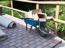 Full up parked wheel barrow on construction site royalty free stock images