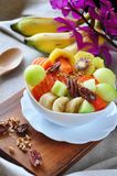 Full of Variety Fruits on Yogurt Bowl. Full of variety fruits and pecan on yogurt bowl stock images
