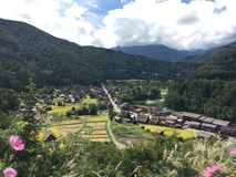 Full view of Gassho-Zukuri farm houses with clear blue sky and clouds in summer, Shirakawago, Gifu, Japan. Shirakawago, Gifu, Japan - September 14th, 2016: Full Royalty Free Stock Photos