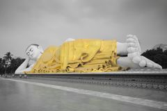 Full View Of Large Mya Tha Lyaung Reclining Or Sleeping Buddha In Black And White With Yellow Robe Royalty Free Stock Images