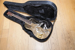 Full view of resonator guitar in carry case Stock Photography