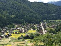 Full view of traditional and historical village and farm houses in summer, Shirakawago, Gifu, Japan. Shirakawago, Gifu, Japan - September 14th, 2016: Full view Stock Image