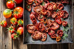 Full of vitamins tomatoes dried in the sun. On wooden table stock photography
