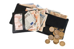Full wallet with bills and coins Royalty Free Stock Images
