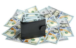 Full wallet on dollar bills Stock Image