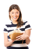 Full wallet-happy woman. A picture of a happy pretty woman with a wallet full of fifty-euro notes over white background Stock Photo