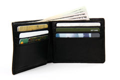 Full wallet with money and gift cards. White background shallow focus stock photo