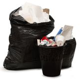 Full wastebasket and plastic bag Stock Images