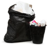 Full wastebasket and plastic bag Royalty Free Stock Image
