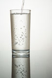 A  full water glass Stock Images