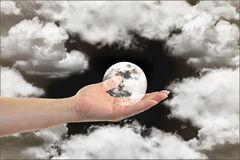 The full white moon in woman hand Stock Photography