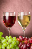 Full wine glasses and grapes Stock Images