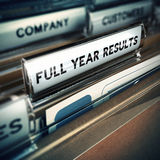 Full Year Financial Results Concept. Folder tab with the text full year results with focus on the word and blur effect. Concept for company report Stock Photography