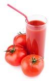 fulla glass tomater för fruktsaftsugrörtomat Royaltyfria Bilder