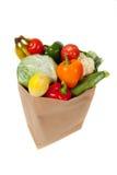fulla livsmedelsbutiksäckgrönsaker arkivbild