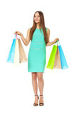 Fullbody portrait of beautiful woman with bags isolated on white Stock Photo