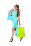 Fullbody portrait of beautiful woman with bags isolated on white Royalty Free Stock Photo
