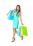 Fullbody portrait of beautiful woman with bags isolated on white Stock Image