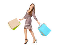 Fullbody portrait of beautiful woman with bags isolated on white royalty free stock photography