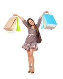 Fullbody portrait of beautiful woman with bags isolated on white Stock Images