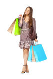 Fullbody portrait of beautiful woman with bags isolated on white Stock Photography