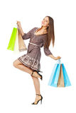 Fullbody portrait of beautiful woman with bags on white royalty free stock images