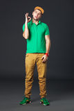 Fullbody portrait of young cool man standing  on dark background Stock Image