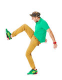 Fullbody portrait of young male kicking in studio isolated on wh Stock Images
