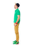 Fullbody profile portrait of young man standing in studio isolat Stock Photos