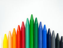 Fullcolor crayon in a spearhead arrangement Stock Photo