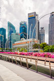 Fullerton hotel building and Jubilee Bridge at Marina Bay Singap Stock Images