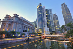 Fullerton Hotel in Luminance. The Fullerton Hotel and the Singapore CBD at early morning Stock Photo