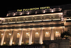 The Fullerton Hotel at Night, Singapore Stock Images