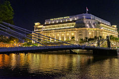 Fullerton Hotel in Singapore. Fullerton Hotel at night by the water in Singapore stock photo