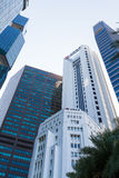 Fullerton Square Skyscrapers. FULLERTON SQUARE, SINGAPORE - JULY 29, 2016: Commercial skyscrapers at the heart of Singapore`s business district line the way from stock photography