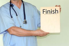 Fullföljandebegrepp doktor med arkivfoto