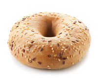 Fullgrain bagel with seeds. Isolated on white background royalty free stock image
