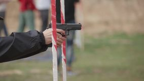 FullHD footage. Man fast firing from pistol at the contest stock footage