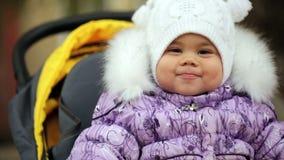 FullHD video of toddler baby girl  in her stroller stock video