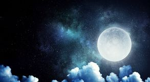 It is fullmoon. Full moon over dark sky with clouds Royalty Free Stock Photo